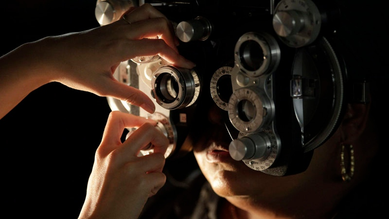 A free eye exam is performed on a patient at the Remote Area Medical clinic inside the Los Angeles Sports Arena on Wednesday, April 28, 2010, in Los Angeles. (AP Photo/Damian Dovarganes)