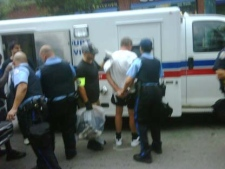 Dozens of people who took part in a G20 march on Queen St. have been taken into custody. (Lisa LaFlamme/CTV News)
