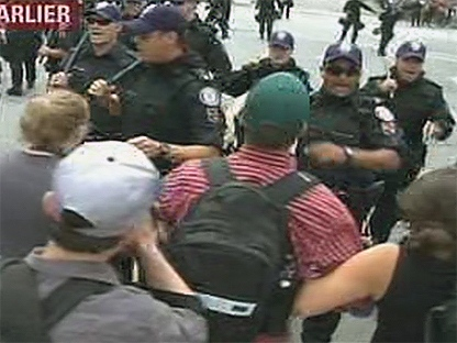 Protesters and police clash in front of the G20 detention centre on Eastern Avenue Sunday.