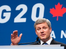 Canadian Prime Minister Stephen Harper speaks during his closing press conference to the G20 Summit in Toronto, Ont., on Sunday June 27, 2010. (THE CANADIAN PRESS/Adrian Wyld)