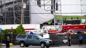Emergency personnel are shown on scene near a collapsed stage at Downsview Park in Toronto on Saturday, June 16, 2012. (The Canadian Press/Nathan Denette)