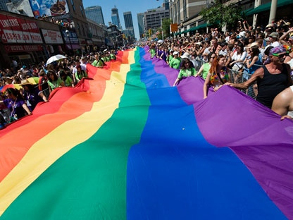 People take part in the Pride Parade in Toronto on Sunday, July 4, 2010. THE CANADIAN PRESS/Adrien Veczan