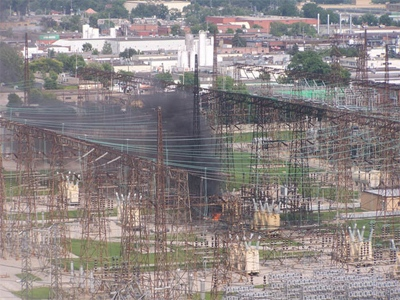 Black smoke rises from a power station where a fire and explosion took place on July 5, 2010.