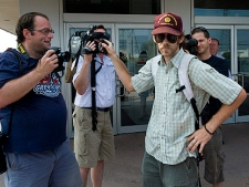 A supporter of the accused ringleaders of the G20 riots confronts media outside an Ontario Court of Justice in Toronto on Tuesday, July 6, 2010. (THE CANADIAN PRESS/Adrien Veczan)