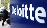 A pedestrian walks past a Deloitte sign in downtown Ottawa in this file photo. (THE CANADIAN PRESS/Sean Kilpatrick(