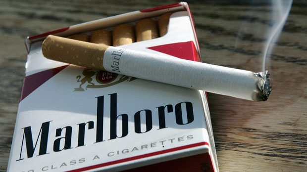In this Jan. 31, 2007 file photo, a Marlboro cigarette burns as it sits on a pack of Marlboro cigarettes in  Trenton, N.J. (AP Photo/Mel Evans, File)