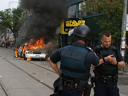 A police car burns in this file photo.