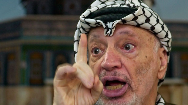 In this Dec. 24, 2002 file photo, Palestinian leader Yasser Arafat talks to the media during a press conference at his headquarters, in the West Bank town of Ramallah. (AP Photo/Muhammed Muheisen, File)