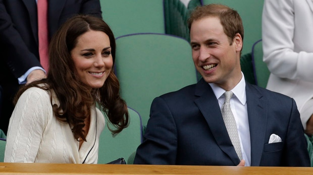 Prince William, right, and Kate, Duchess of Cambridge, watch Roger Federer play Mikhail Youzhny during a quarterfinals match at the All England Lawn Tennis Championships at Wimbledon, England, Wednesday July 4, 2012. (AP Photo/Anja Niedringhaus)