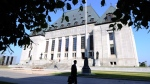 A pedestrian walks past the Supreme Court of Canada in Ottawa. (The Canadian Press/Sean Kilpatrick)