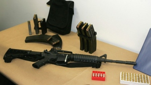 A Bushmaster AR-15 semi-automatic rifle and ammunition is seen at the Seattle Police headquarters in Seattle, March 27, 2006. (AP / Ted S. Warren)