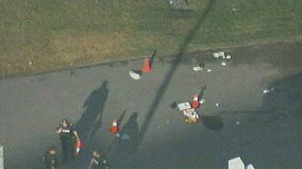 This screen grab from Chopper 24 shows police officers outside a veterinary clinic in Pickering after a male was shot by police Monday, July 16, 2012.