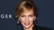 Actress Uma Thurman poses for a photo backstage at the Tommy Hilfiger Fall 2012 show during Fashion Week in New York, Sunday, Feb. 12, 2012. (AP Photo/ Donald Traill)