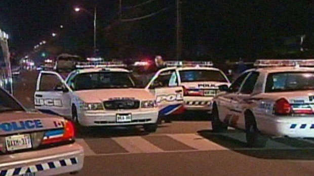 Police vehicles are seen in this photo following a shooting on Danzig Street in Scarborough on Monday, July 16, 2012.