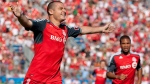 Toronto FC 's Danny Koevermans (left) celebrates scoring his team's first goal against New England Revolution as Ryan Johnson looks on during first half MLS action in Toronto on Saturday, June 23, 2012. (The Canadian Press/Chris Young)