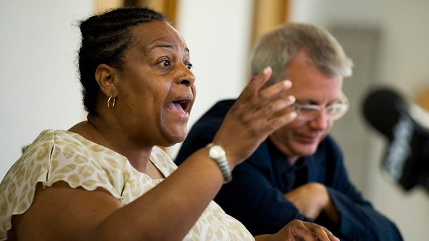 Margaret Parsons of the African Canadian Legal Clinic speaks next to Coun. Adam Vaughan during a press conference to speak out against gun violence at the Don Montgomery Centre in Toronto on Thursday, July 19, 2012. (The Canadian Press/Aaron Vincent Elkaim)