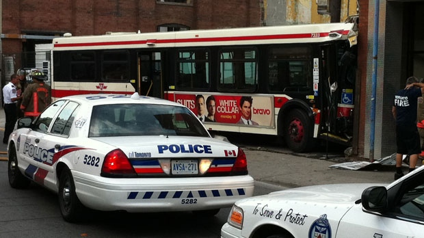 Police are on the scene after a Toronto Transit Commission bus collided with a building on Peter Street on Sunday, July 22, 2012.