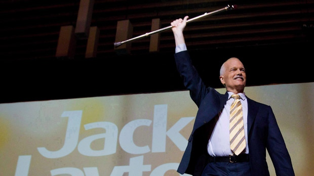 Jack Layton raises his cane as he prepares to deliver his keynote speech to the party's 50th anniversary convention in Vancouver, B.C., on Sunday, June 19, 2011. (The Canadian Press/Darryl Dyck)