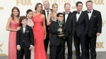 """Modern Family"" cast members pose backstage at the 63rd Primetime Emmy Awards on Sunday, Sept. 18, 2011 in Los Angeles. (AP Photo/Jae Hong)"