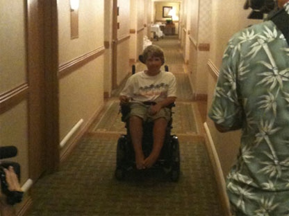 In this file photo, Tanner Bawn rides in his new wheelchair as seen in this image courtesy Catherine Connors, Thursday, Aug. 5, 2010.