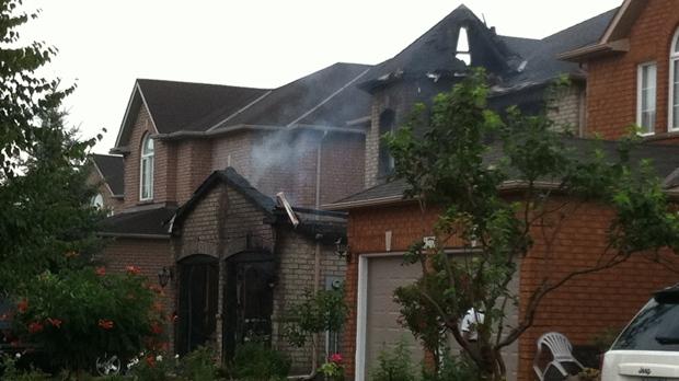 Firefighters battled a blaze at a home on Coalbrook Court on Thursday, July 26, 2012. (CP24/Tom Stefanac)