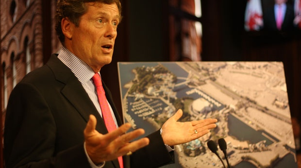 FILE - John Tory gestures to reporters beside an aerial image of Ontario Place. (Chris Fox/CP24.com)