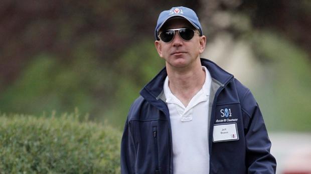 Amazon CEO and founder Jeff Bezos arrives at the Allen & Company Sun Valley Conference in Sun Valley, Idaho, Friday, July 13, 2012. (AP Photo/Paul Sakuma)