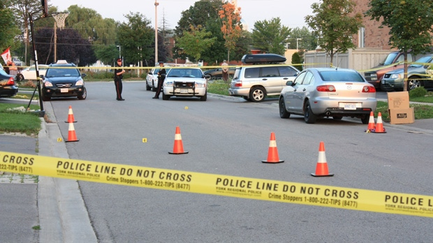 Police investigate on Colombo Crescent in Vaughan on Thursday, Aug. 2, 2012, after a man was killed and a second was wounded in a double stabbing the night before. (CP24/Tom Stefanac)