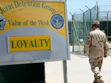 A sailor walks past a sign at the detention camp where Canadian Omar Khadr is being held on Wednesday, Aug. 11, 2010, in Guantanamo Bay, Cuba. (THE CANADIAN PRESS/Colin Perkel)