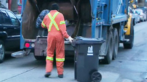 A City of Toronto employee dumps trash into a garbage truck in this file photo.