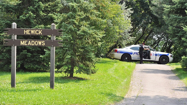 Police block off access to Hewick Meadows Park in Mississauga after discovering a female severed head in the Credit River on Thursday, Aug. 16, 2012. (The Canadian Press/Aaron Vincent Elkaim)