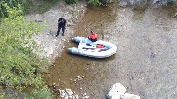 Police search the Credit River in Mississauga on Friday, Aug. 17, 2012. (Christina Tenaglia)