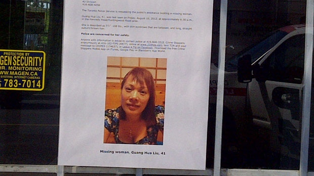 A missing person's notice hangs outside a business near Guang Hua Liu's spa Tuesday, August 21, 2012.