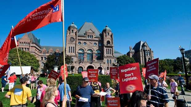Teachers gather prior to a rally at Queen's Park in Toronto on Tuesday, Aug. 28, 2012. (CP Photo/ Aaron Vincent Elkaim)