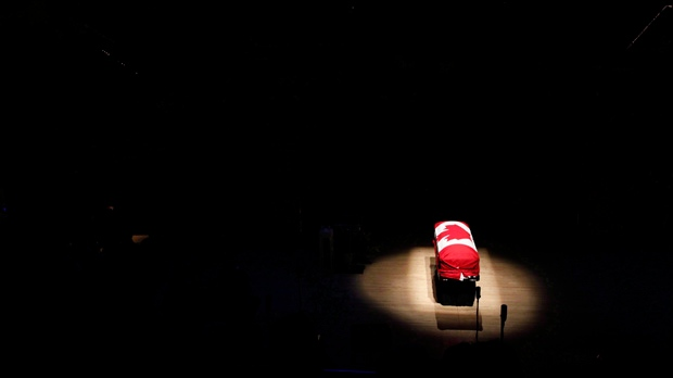 The coffin of late NDP Leader Jack Layton sits under a spotlight during his state funeral at Roy Thomson Hall in Toronto on Aug. 27, 2011. (Frank Gunn / THE CANADIAN PRESS)