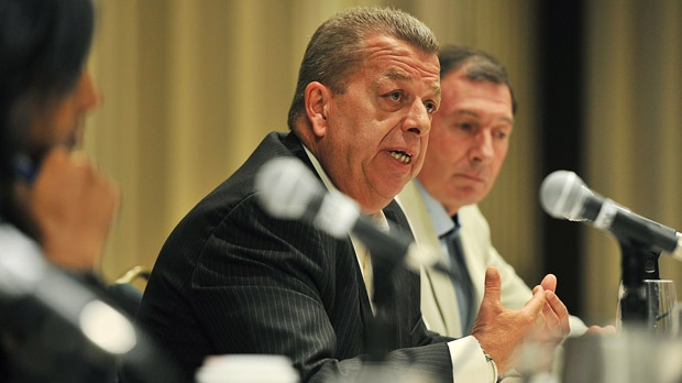 Sam Hammond, left, president of the Elementary Teachers' Federation of Ontario, speaks during a press conference in Toronto on Aug. 30, 2012. (The Canadian Press/Aaron Vincent Elkaim)
