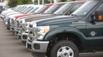 Unsold 2011 Ford F-350 pickup trucks sit at a dealership in the west Denver suburb of Lakewood, Colo. on June 27, 2010. (AP / David Zalubowski)