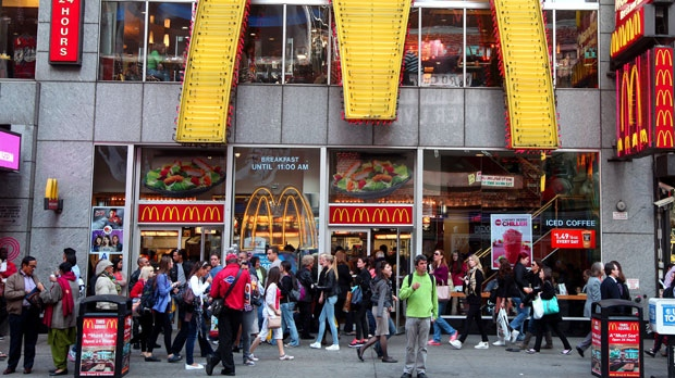 In this May 6, 2012, photo, people walk around a McDonald's restaurant in New York's Time Square. (AP Photo/CX Matiash)