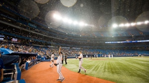 The retractable roof of the Rogers Centre gets stuck open as the rain begins to fall during the sixth inning of the Toronto Blue Jays game against the Baltimore Orioles in Toronto on Tuesday, Sept. 4, 2012. (The Canadian Press/Aaron Vincent Elkaim)