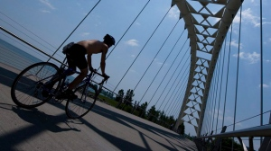 A cyclist crosses a bridge over the Humber River in Toronto. (The Canadian Press/Adrien Veczan)