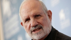 Director Brian De Palma poses at the photo call of the film 'Passion' at the 69th edition of the Venice Film Festival in Venice, Italy, on Friday, Sept. 7, 2012. (AP Photo/Andrew Medichini)