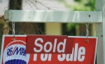 A house 'sold' sign is shown in Oakville, Ont., Monday, July 23, 2012. (Richard Buchan / THE CANADIAN PRESS)