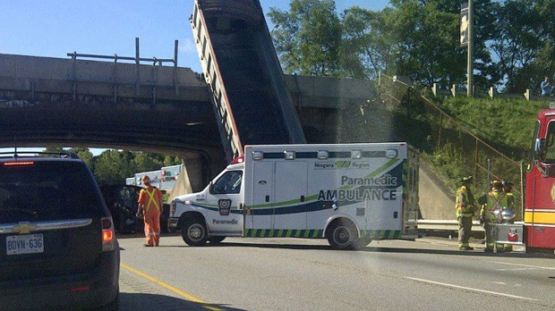 A dump truck's elevated box struck an overpass on the QEW at Lundy's Lane in Niagara Falls on Wednesday, Sept. 19, 2012. (Niagara Regional Police Service photo)