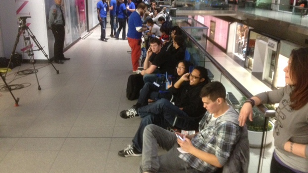 Dozens of people lined up outside the Apple store at Toronto's Eaton Centre on Friday, Sept. 21, 2012, to be among the first to buy the iPhone 5. (CP24/Cam Woolley)