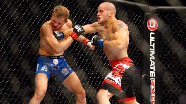 Ultimate Fighting Championship fighters Mitch Gagnon, right, from Sudbury, Ont., and Bryan Caraway, from the United States, do battle during UFC 149 in Calgary, Alta., Sat., July 21, 2012. (CP Photo/Jeff McIntosh)