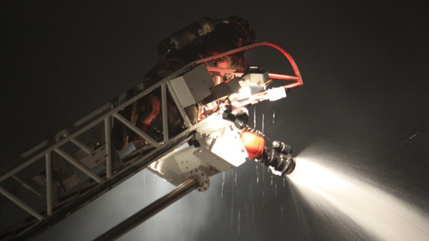 Firefighters battle a house fire on Keele Street early Tuesday, Sept. 25, 2012. (CP24/Tom Stefanac)