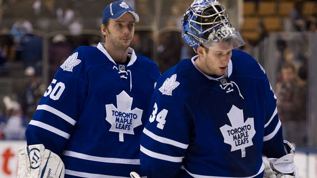 Toronto Maple Leafs goalies Jonas Gustavsson, left, and James Reimer, right, leave the ice after being defeated by the Washington Capitals 4-2 in NHL hockey action in Toronto on Saturday, Feb. 25, 2012. (The Canadian Press/Nathan Denette)