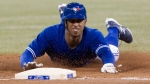 Toronto Blue Jays Anthony Gose slides into third base after a single by Brett Lawrie during the second inning of MLB American league baseball action in Toronto on Sunday Sept.30 , 2012. (CP Photo/Chris Young)