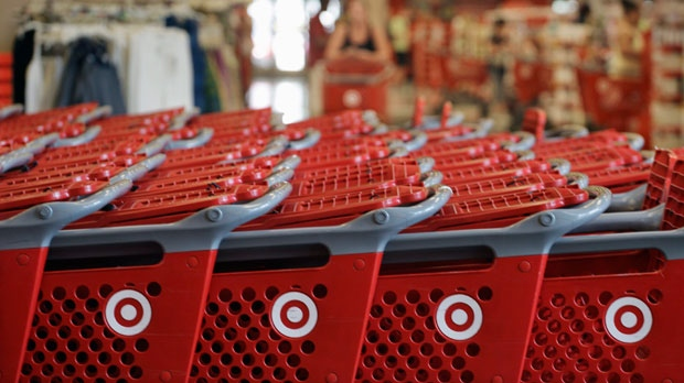 In this Thursday, July 5, 2012, file photo, rows of carts await customers at a Target store in Chicago. (AP Photo/M. Spencer Green)