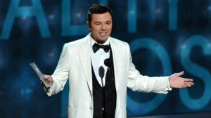 This Sept. 23, 2012 file photo shows Seth MacFarlane presenting an award at the 64th Primetime Emmy Awards at the Nokia Theatre in Los Angeles. (Photo by John Shearer/Invision/AP)
